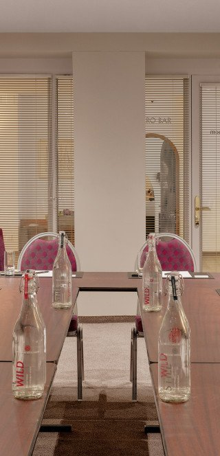 Prepared meeting table at the Boardroom of the Morosani Hotel
