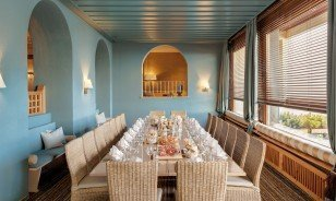 "Long prepared table at the Veranda in the Morosani ""Schweizerhof"""